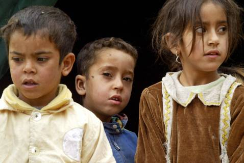 Internally displaced Iraqi Shiite children stand at the entrance of their tent at an IDP camp on the outskirts of Sadr City, 05 December 2007. More than 25 Shiite families fled the village of Duailiyah in Diyala province after being attacked by AQI militants.