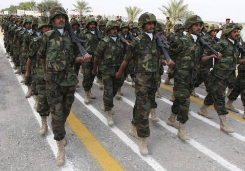 BASRA, IRAQ - DECEMBER 16: Iraqi security forces march during a handover ceremony on December 16, 2007, in Basra, 340 miles south of Baghdad, Iraq.