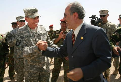 Iraqi National Security Advisor Muwaffak al-Rubaie shakes hands with American Gen. David Petraeus in Taji in June.