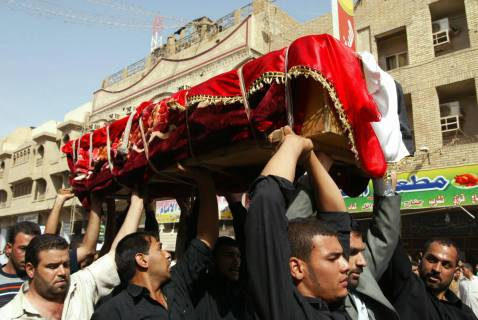 Relatives and friends of assassinated Iraqi MP Salih al-'Ukayli carry his coffin through Najaf during his funeral on October 10.