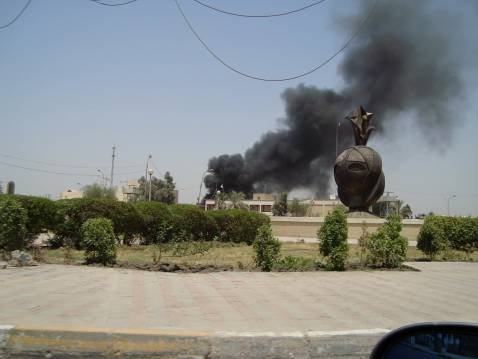 Black smoke rises over Baghdad's Nissour Square area on Monday.