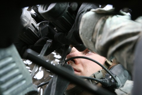 BBCPfc. Jeff Lawniczak, 22, of Milwaukee, Wis., sits in the gunner's turret in a Humvee, scanning for enemy activity through a pair of binoculars.