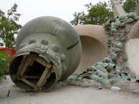 Iranian Army helmets at the base of The Hands of Victory monument.