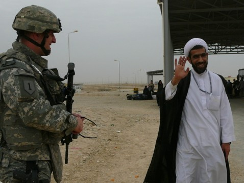 U.S. Army captain and Shiite cleric crossing Iran/Iraq border acknowledge each othe
