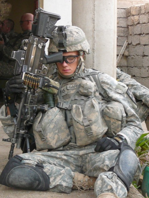 Private First Class Chris Garrett from the 5-20 Stryker Battallion catches a few minutes of sleep