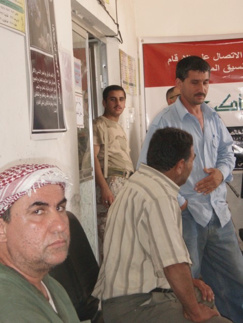 Iraqi hostages freed last week in Baquba by U.S. forces wait at Iraqi security station.