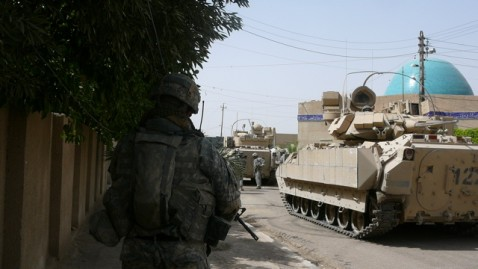 US Army Stryker vehicle rolls past mosque in Amiryah Sunday.
