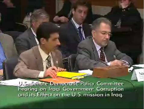 Salam Adhoob (L), speaking through a translator (R) on Capitol Hill yesterday.