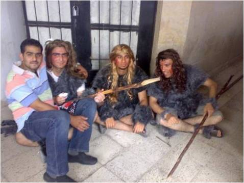 Students dressed as cavemen for the graduation ceremonies.