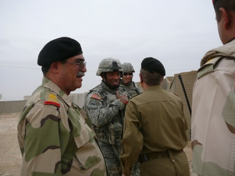 Brigadier General Dana Pittard, in charge of transition teams, greets Iraqi official. Iraqi Major General Mohsen Abdul Hassen looks on