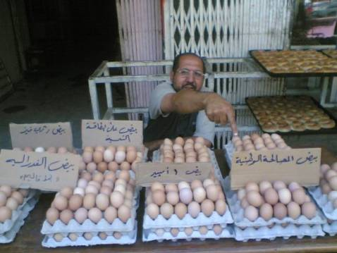 An Iraqi egg seller points to his national reconciliation eggs which he sells alongside such varieties as solar powered eggs and federalism eggs.