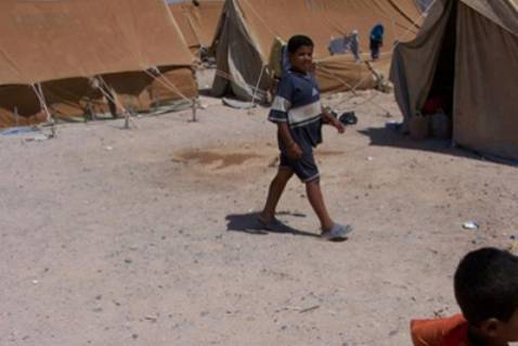 A Palestinian refugee child from Iraq in a desert camp on the Iraqi-Syrian border, 2006.