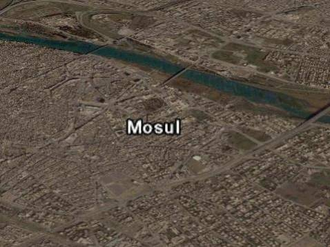The Tigris River running through central Mosul.