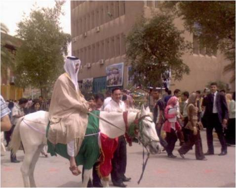 A graduate dons traditional Arab garb and rides a horse for the festivities.