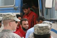 Detainees getting off a bus