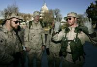 WASHINGTON - MARCH 19: Iraq Veterans Against the War members, including USMC Sgt. Adam Kokesh (L), 25, of San Mateo, California, talk before a news conference across the street from the U.S. Capitol March 19, 2007 in Washington, DC.