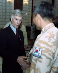 New US Ambassador to Iraq Ryan Crocker shakes hands with an unidentified South Korean officer after his swearing-in ceremony held at the US Embassy in Baghdad, 29 March 2007.