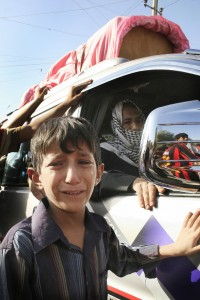 An Iraqi boy cries as he follows a car carrying the coffin of a relative killed during a US military air strike in the predominantly Shiite Baghdad suburb of Sadr City, 08 August 2007.