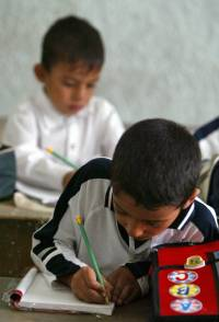 Iraqi school boys attend the first day of classes, 30 September 2007 in Baghdad.