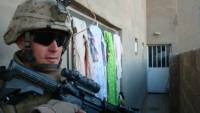 Marine from the 5th Anglico preparing to sweep a home for weapons in Ramadi.