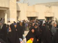 Displaced Families Arrive at Sadr City's Council Building to Receive Humanitarian Aid