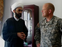 Sheikh Ahmed al-Tamimi meets US Army brigade commander Colonel David Sutherland near Baquba.