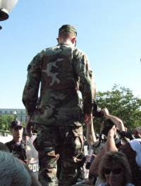 A member of Iraq veterans against the war walks the wall towards his arrest at the anti-war protest on Capital Hill September 15, 2007.