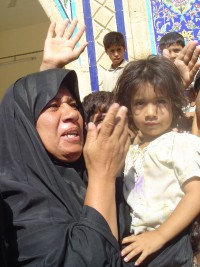 A woman and child living temporarily at the Imam Zaid Shrine between Hilla and Najaf. Many Najaf residents fled to the shrine and others nearby to escape fighting in their city.